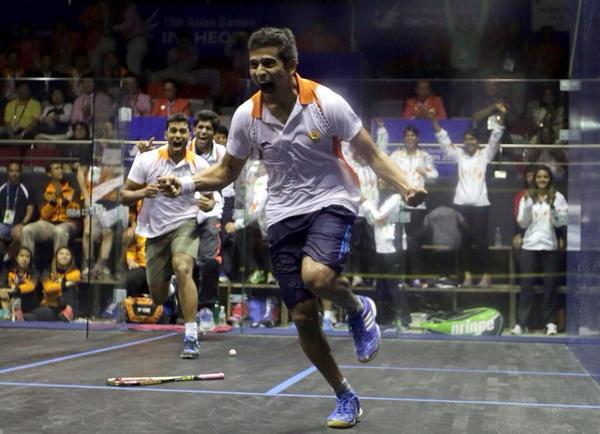 GOLDEN BOY: Saurav Ghosal goes wild as he celebrates his gold medal