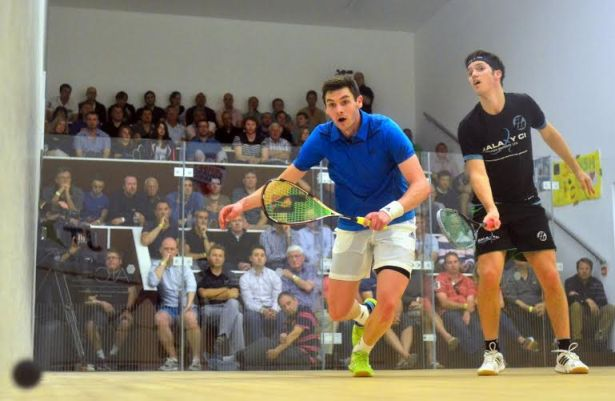 Adrian Waller (left) and Chris Simpson battle it out in the final of the Jersey Classic in front of a full house