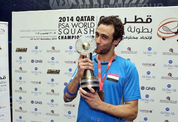 The 2014 world champion Ramy Ashour kisses the trophy