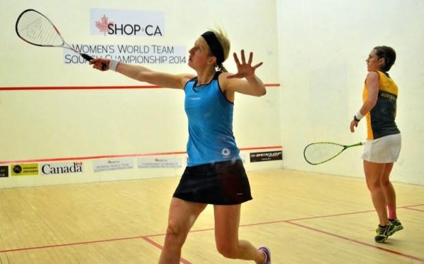 Alison Waters volleys against Rachael Grinham