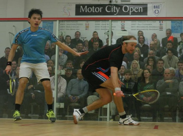 Steve Coppinger plays a drop from mid-court against Max Lee
