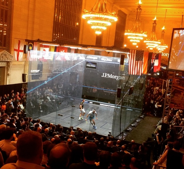 The chandeliers light up the glass court as Mohamed Elshorbagy overcomes Amr Shabana