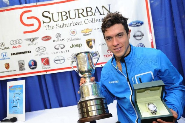 CHAMPION: Colombian Miguel Angel Rodriguez poses with the trophy and Rolex watch after winning the Motor City Open  (Photo by Bryan Mitchell)