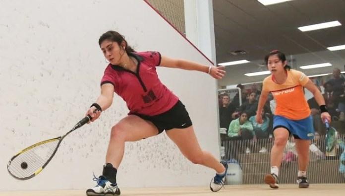 Nour El Sherbini (front) in action against Annie Au