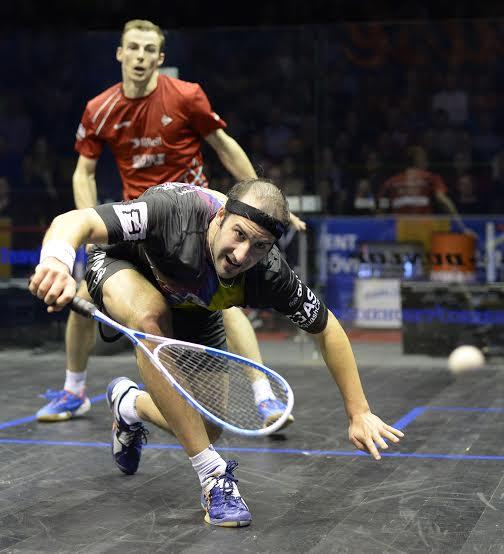 Simon Rosner bends into a drop shot against Nick Matthew