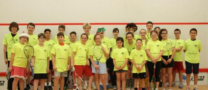 Happy children loving life on a squash court!