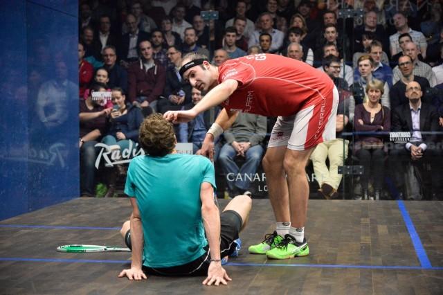 Simon Rosner checks on Lucas Serme after a mid-court collision