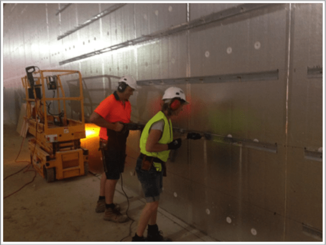 Sarah Fitz-Gerald gets to work with a power drill in Canberra