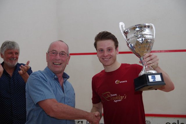 Charles receives the Kent Open trophy from John Powell of Select Gaming
