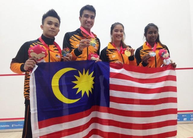 Team Malaysia celebrate (left to right): Addeen Idrakie, Sanjay Singh, Rachel Arnold, Vanessa Raj