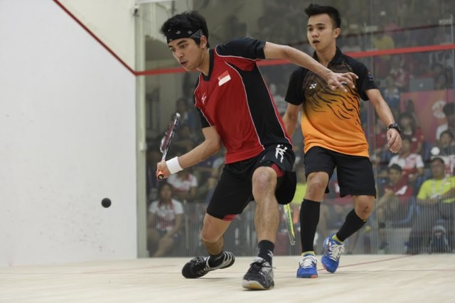 Singapore's Samuel Kang (front) comes just short against Addeen Idrakie in the opening tie.