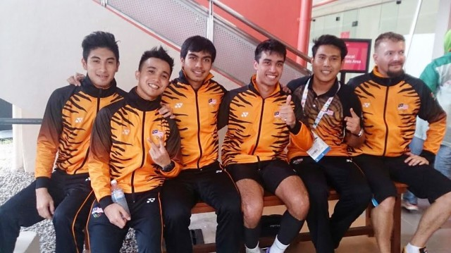 The happy men's team after winning Malaysia's fourth squash gold (l-r) Valentino Bong, Addeen Idrakie, Syafiq Kamal, Sanjay Singh, team physio Zariff and coach Mika Monto