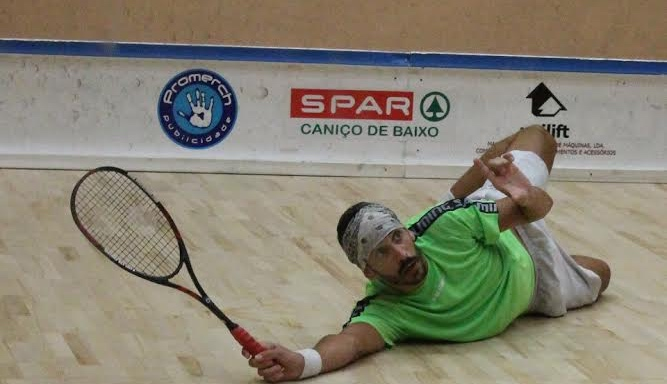 Down and out: Top seed Alejandro Caro takes a tumble against George Parker