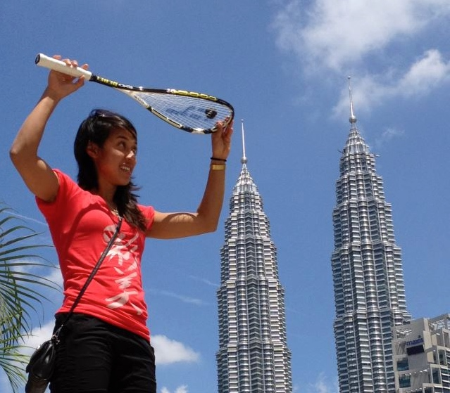 Malaysian star Nicol David in front of the Petronas Towers