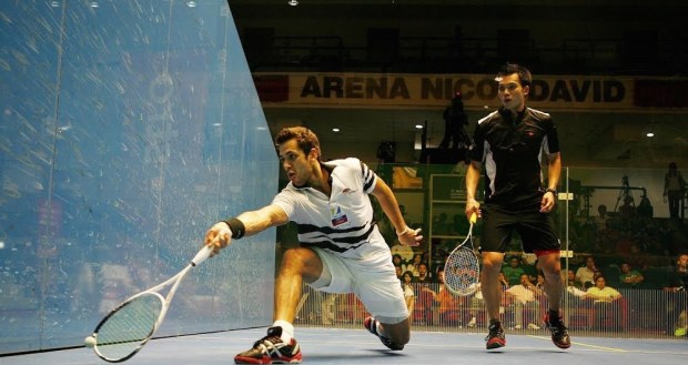 Azlan (left) in action against fellow Malaysian Ong Being Hee