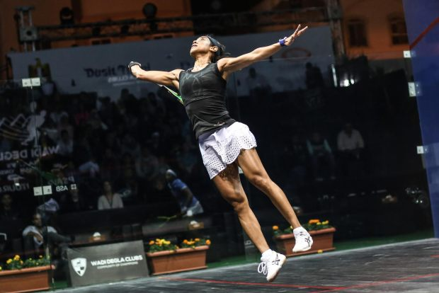 Nicol David leaps through the air to volley