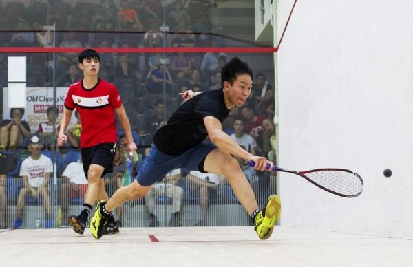 James Huang stretches for a retrieve