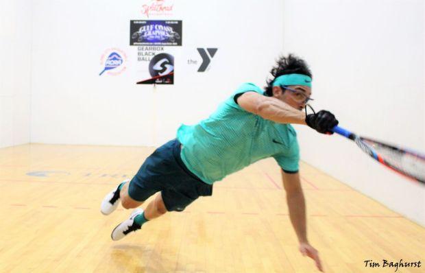 Alex Landa dives across the court