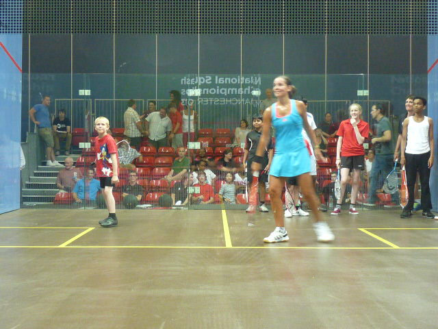 Jenny Duncalf on court with youngsters