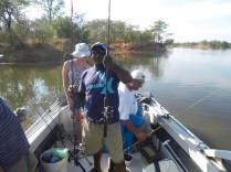 Captain Daniel helping some guests find rods.