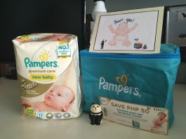 A pack of Pamper's newborn diapers in a cute tote (which is now Squishy's first aid kit).