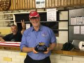 Drew and his award (Brett behind the bar)