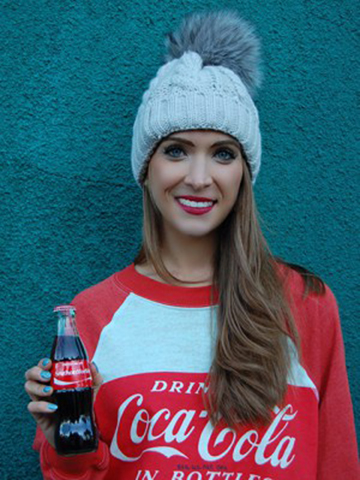 Stacy spreading holiday cheer with our personalized Coca-Cola bottles!
