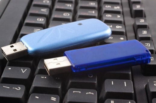 Two USB devices over a black keyboard