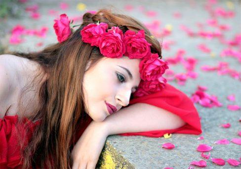 deep sad girl in love with rose petals