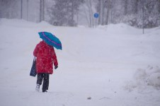 Red cape and blue umbrella