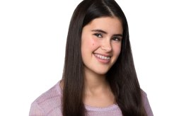 Smiling girl with braces in actress headshot