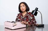Portrait of Author at work at wer typewriter