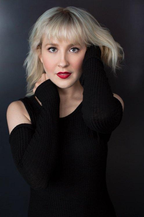 Headshot of Blonde Actress in Black Dress