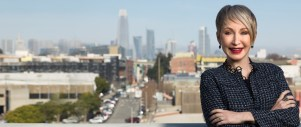 Personal Branding Photography of Executive Coach with arms folded in front of the San Francisco Skyline