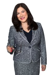 Portrait of businesswoman holding glasses