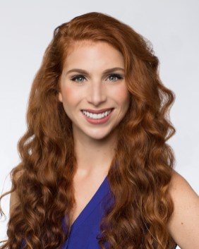 Actor Headshot of Woman with Red Hair and Green Eyes
