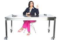 Personal Branding Photography of a Woman at desk in pajama bottoms and a suit jacket.