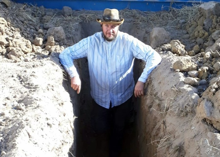 shipping container house footings standing in hole for clay
