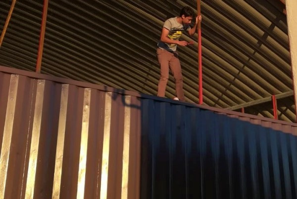 weather proofing the container house with red oxide paint