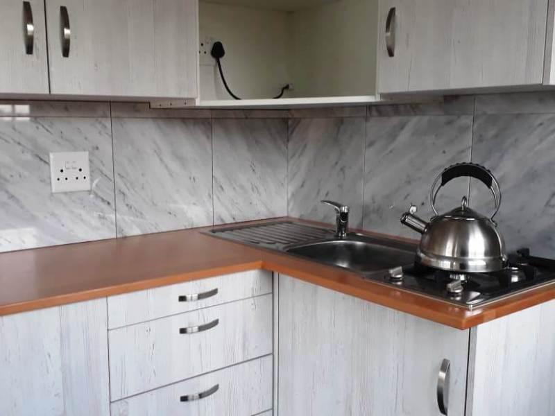 Marble Tile Back splash in kitchen coffee station