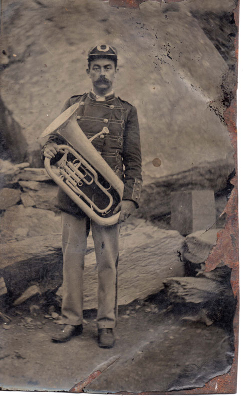 Brass band member with euphonium Unknown photographer Date unknown 6th plate tintype Sheila Masson Collection This uniformed euphonium player is most likely a member of a large brass band, possibly affiliated to a quarry town in England or Wales.