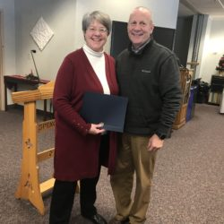 Dr. Keith Taylor (RIGHT), President  of Gannon University, presents the Gannon University/Metz Culinary Management Thanksgiving Giving back Award to Vicki Washek of L'Arche.