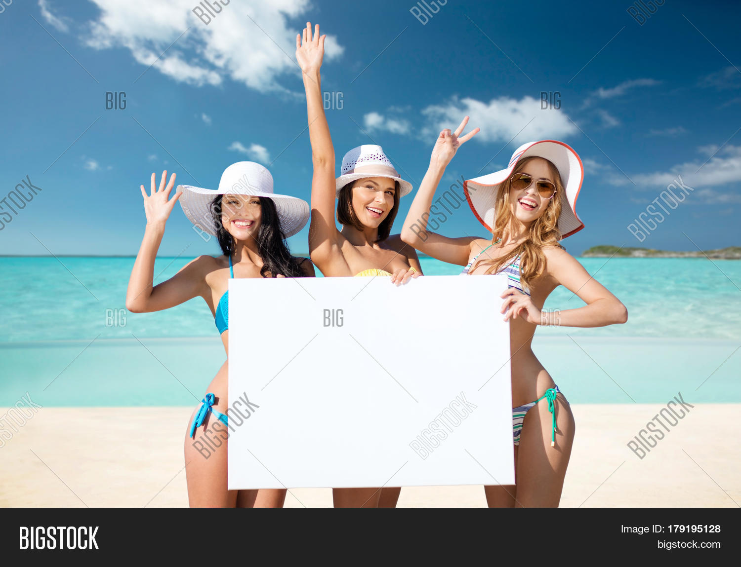 Summer Holidays Travel People Advertisement And Vacation Concept Happy Young Women In Bikinis H 179195128 Image Stock Photo
