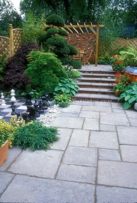 Bluestone paver patio with inlaid chess set, plantings ...