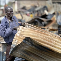 Bor Roofing Man Scavenges Tin Sheets From Market In War Torn South Sudan City