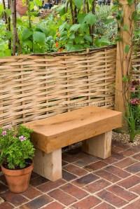 Garden bench on brick patio   Plant & Flower Stock ...