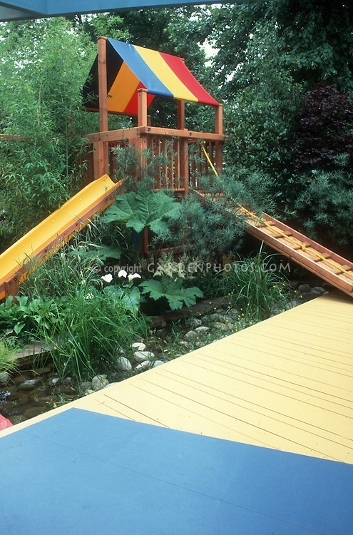 Treehouse for children with slide  Plant  Flower Stock