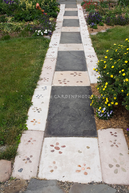 Concrete and flagstone paver walkway decorated with pebbles  Plant  Flower Stock Photography