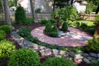 Small round patio garden in shade | Plant & Flower Stock ...