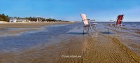 Two beach chairs in water. Outdoor furniture on Prnu ...